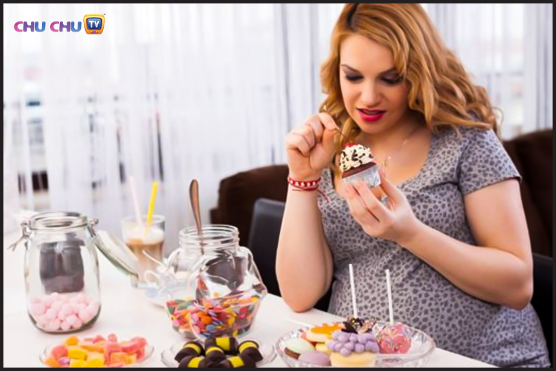 A pregnant lady gorging on cake