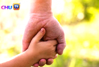 kid holding hand of her father