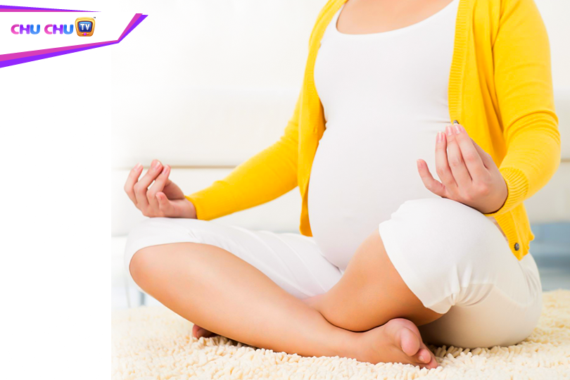 Picture of a pregnant lady doing prenatal exercises supported by someone
