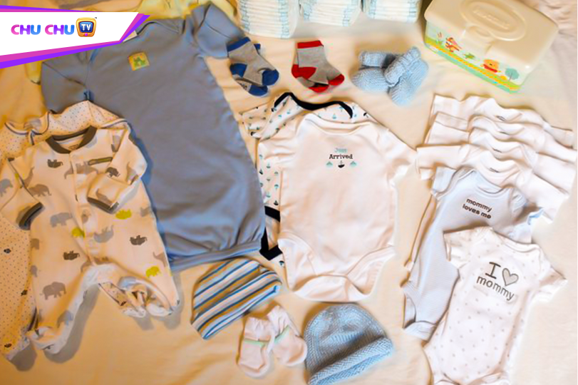 Picture of a baby cot, some clothes etc