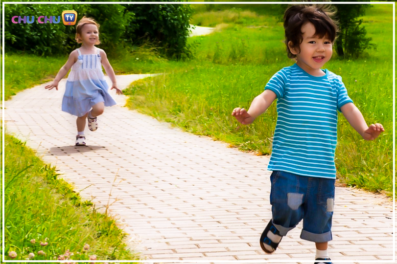Boy and girl running around