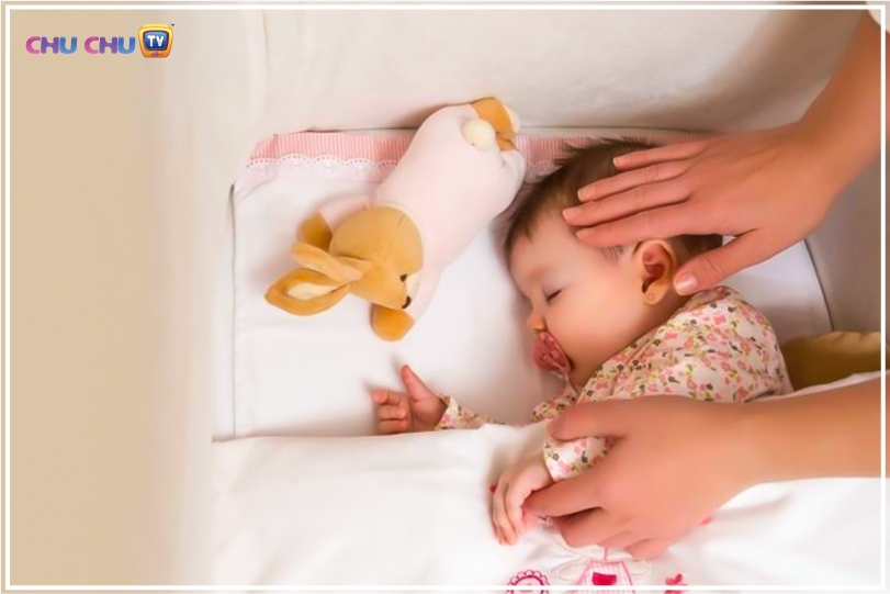 mother hand on sleeping baby