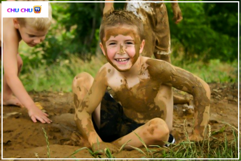 boy playing in mud